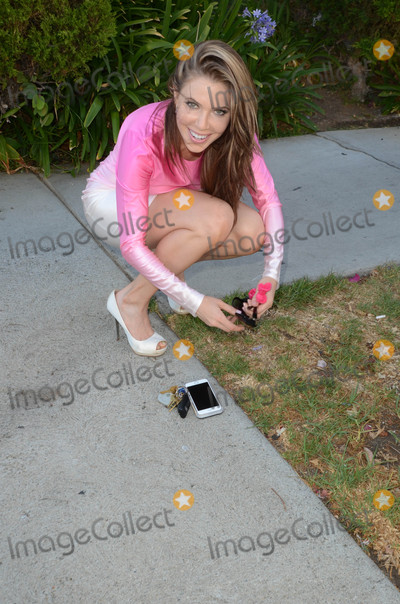 Photos From Erika Jordan spotted walking her dog in a stylish dress
