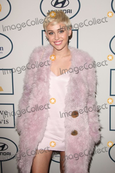 Miley Cyrus Photos - Photo by Quasarstarmaxinccom2014ALL RIGHTS RESERVEDTelephoneFax (212) 995-119612514Miley Cyrus at a Pre-Grammy party(Los Angeles CA)