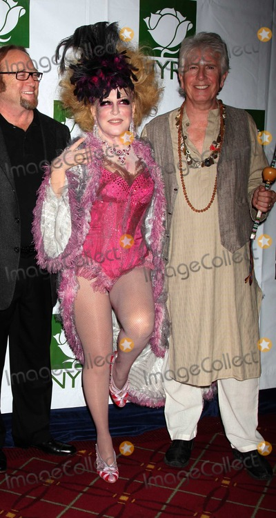 Bette Midler Photo - Crosby Stills Nash Midler8431JPGNYC  103009Bette Midler (dressed as a Showghoul) with David Crosby Stephen Stills and Graham Nash at Bette Midlers annual HULAWEEN Gala supporting New York Restoration Project at the Waldorf AstoriaDigital Photo by Adam Nemser-PHOTOlinknet