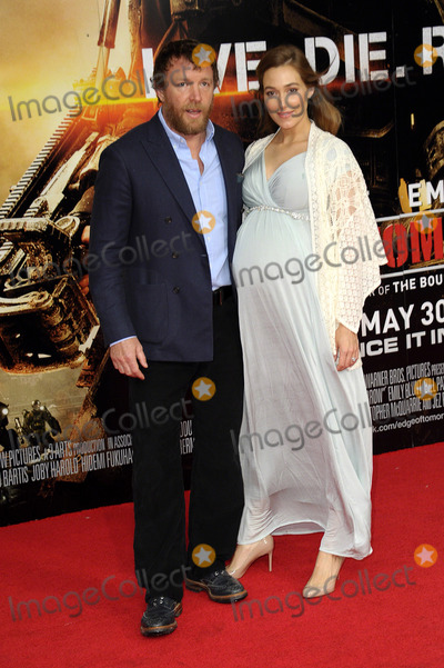 GUY RICHIE Photo - May 28 2014 LondonJacqui Ainsley and Guy Richie (L)  attend the world premiere of The Edge Of Tomorrow at The Imax on May 28 2014 in London England