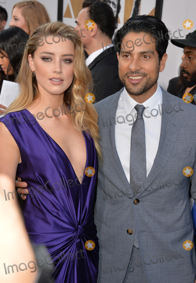 Adam Rodriguez Photo - Amber Heard  Adam Rodriguez at the world premiere of their movie Magic Mike XXL at the TCL Chinese Theatre HollywoodJune 25 2015  Los Angeles CAPicture Paul Smith  Featureflash