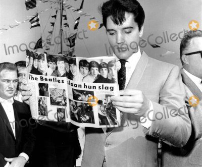 Elvis Presley,Beatles,The Beatles Photos - Photographer Gives Elvis Presley a Danish Magazine with an Article About the Beatles Bud GrayptGlobe Photos