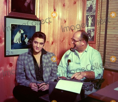 Elvis Presley Photos - Elvis Presley and Colonel Parker Photo Globe Photos Inc