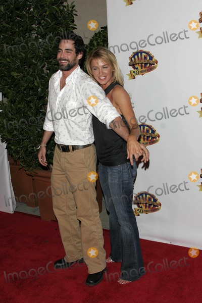 Adam Cauffman Photo - Poppy Montgomery and Boyfriend Adam Cauffman - Warner Bros Television and Warner Home Video Celebrate 50 Years of Quality Tv - Warner Bros Lot Stage 6 Burbank CA - 01-20-2005 - Photo by Nina PrommerGlobe Photos Inc2005
