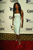 Carlos Santana Photo - Kenya Moore at the Deborah and Carlos Santana Milagro Foundation Benefit on the rooftop of the Hyatt On Sunset West Hollywood CA 08-31-04
