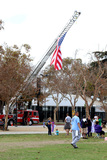 American Flag Photo - LOS ANGELES - OCT 16  American Flag on Fire Truck Atmosphere at the ALS Association Golden West Chapter Los Angeles County Walk To Defeat ALS at the Exposition Park on October 16 2016 in Los Angeles CA
