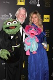Caroll Spinney Photo - LOS ANGELES - JUN 23  Caroll Spinney left and Leslie Carrara Rudolph pose with puppets Oscar the Grouch left and Abby  arrives at the 2012 Daytime Emmy Awards at Beverly Hilton Hotel on June 23 2012 in Beverly Hills CA