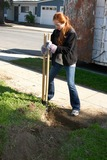Hole Photo - LOS ANGELES - FEB 9  Emily Wilson digging new fence post hole at the 4th General Hospital Habitat for Humanity Fan Build Day at the 191 E Marker Street on February 9 2013 in Long Beach CA