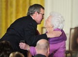 Jeb Bush Photo - Former first lady Barbara Bush prepares to kiss her son former Florida Governor Jeb Bush prior to the ceremony where United States President Barack Obama and first lady Michelle Obama honored recipients of the 2010 Medal of Freedom the Nations highest civilian honor presented to individuals who have made especially meritorious contributions to the security or national interests of the United States to world peace or to cultural or other significant public or private endeavors in a ceremony in the East Room of the White House in Washington DC on Tuesday February 15 2011Photo by Ron SachsCNP-PHOTOlinknet