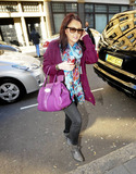 Lacey Turner Photo - EastEnders actress Lacey Turner carries a can of Coca-Cola and wears brightly colored clothes as she arrives at BBC Radio 1 London UK 030711