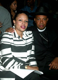 Rev Run Photo - Reverend Run (Run Dmc) and His Wife at Baby Phat by Kimora Lee Simmons Showing of Spring Collection in Gertrude Tent at Bryant Park in New York City on September 13 2003 Photo Henry Mcgee Globe Photos Inc 2003