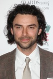 Aidan Turner Photo - Aidan Turner arriving for the 2014 Empire Film Awards at the Grosvenor House Hotel London 30032014 Picture by Alexandra Glen  Featureflash
