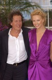 Geoffrey Rush Photo - CHARLIZE THERON  GEOFFREY RUSH at photocall at the Cannes Film Festival for their new movie The Life  Death of Peter SellersMay 21 2004