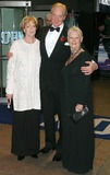 Judi Dench Photo - London Dame Maggie Smith Director Charles Dance and Dame Judi Dench arrive at the film premiere of Ladies in Lavender in Leicester Square08 November 2004Jenny RobertsLandmark Media