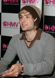 Harry Judd Photo - Milton KeynesUK Harry Judd  of pop music band  McFly sign copies of their new double A sided single Transylvania Babys Coming Back at HMV Milton Keynes  9th May 2007   Keith MayhewLandmark Media
