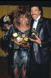 Tina Turner Photo - Tina Turner and Lionel Ritchie at the Grammys Awards 1985 13577 Photo by Phil Roach-ipol-Globe Photos Inc