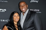 Magic Johnson Photo - Cookie Johnson Magic Johnson attending the Los Angeles Premiere of Olympus Has Fallen Held at the Arclight Cinerama Dome in Hollywood California on March 18 2013 Photo by D Long- Globe Photos Inc