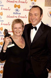 Judi Dench Photo - Dave BenettalphaGlobe Photos Inc 054173 02202004 Dame Judi Dench Winner of the Special Award with Kevin Spacey -the Laurence Olivier Theatre Awards at the Hilton Park Lane London