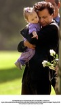 Sophie Blake Photo - Actor Robert Blake hugs his 11-month-old daugther Rose Lenore Sophie Blake as she leans down to grab a white rose picked from the coffin bearing her slain mother Bonny Lee Bakley during a brief funeral ceremony in Los Angeles Friday May 25 2001  PHOTO SUPPLIED BY GLOBE PHOTOS INCAP POOL K21950NP