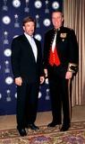 Chuck Norris Photo - Sd1212 American Veteran Beverly Hills California Chuck Norris and Genereal James L Jones Photo Paul Skipper  Globe Photos Inc 2000 Chucknorrisretro