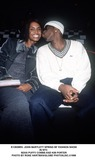 Sean Puffy Combs Photo -  John Bartlett Spring 99 Fashion Show in NYC Sean Puffy Combs and Kim Porter Photo by Rose HartmanGlobe Photosinc