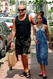 Gianni Versace Photo - Gianni Versace and Daughter Strolling in South Beach in Florida Photo by Adam ScullGlobe Photos Inc 1997 Sternrequest
