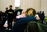 JFK Photo - Anti-war Demonstration Masked Demonstrators Make Love Not War Jfk Memorial Dallas Tx 02-15-03 L-star (Lincoln NE) R-cri (Fort Worth TX) Photojeff Newman  Globe Photos Inc 2003