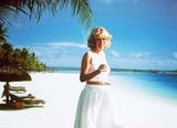 Camilla Parker-Bowles Photo - Photomontage Supplied by Alpha M040249 05_04_00 Mauritius Indian Ocean camillas Holiday at Le Saint Geran Hotel Camilla Parker Bowles Enjoys the Beach