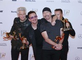 Adam Clayton Photo - Adam Clayton (l-r) Bono the Edge Und Larry Mullen Junior Von U2 Pose at the Winners Photocall of the Bambi Awards at Stage Theatre in Berlin Germany on 13 November 2014 Photo Alec Michael Photo by Alec Michael- Globe Photos Inc