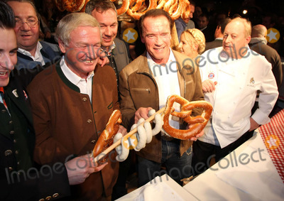 Photo - Arnold Schwarzenegger attends the White Sausage Party
