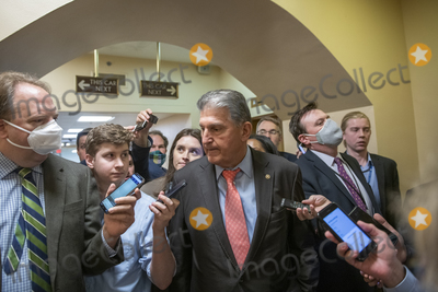 Photo - United States Senator Joe Manchin III (Democrat of West Virginia) is surrounded by reporters as he makes his way through the Senate subway during a vote at the US Capitol in Washington DC Wednesday July 21 2021 Credit Rod Lamkey  CNPAdMedia