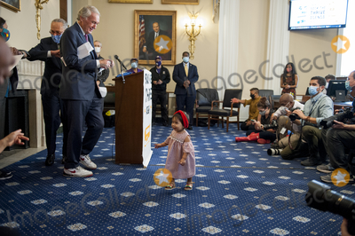 Photo - One year-old Dara Farez playfully joins United States Senate Minority Leader Chuck Schumer (Democrat of New York) and US Senator Ed Markey (Democrat of Massachusetts) and others for a press conference of a coalition of grassroots groups labor unions Black Brown and Indigenous leaders from across the nation for the introduction of a bold plan for economic renewal known as the Transform Heal and Renew by Investing in Vibrant Economy (THRIVE) in the Longworth House Office Building on Capitol Hill in Washington DC Thursday September 10 2020 Credit Rod Lamkey  CNPAdMedia