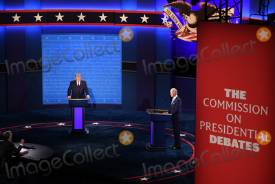 Photo - President Donald Trump and Democratic presidential nominee Joe Biden with moderator Chris Wallace prepare to face off in the first of three scheduled 90 minute presidential debates in Cleveland Ohio on Tuesday September 29 2020 Credit Kevin Dietsch  Pool via CNPAdMedia