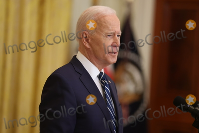 Photos From DC: President Biden hosts first presidential press conference