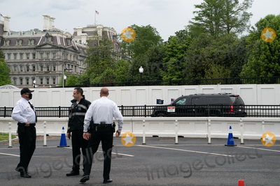 Jill Biden Photo - The motorcade carrying US President Joe Biden and First Lady Jill Biden drives towards the Ellipse of the White House in Washington DC US on Monday May 3 2021 Bidens 4 trillion vision of remaking the federal governments role in the US economy is now in the hands of Congress where both parties see a higher chance of at least some compromise than for the administrations pandemic-relief bill Credit Erin Scott  Pool via CNPAdMedia