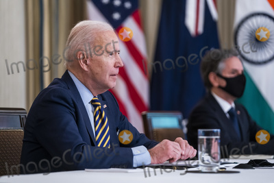 Antony Blinken Photo - US President Joe Biden (L) and Secretary of State Antony Blinken (R) meet virtually with their counterparts in the Quad Prime Minister Narendra Modi of India Prime Minister Scott Morrison of Australia and Prime Minister Yoshihide Suga of Japan from the State Dining Room of the White House in Washington DC USA 12 March 2021Credit Jim LoScalzo  Pool via CNPAdMedia