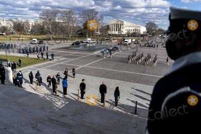 Photo - WASHINGTON DC - JANUARY 18 2021 On the East Front steps of the US Capitol lined by Honor Guard during Pass and Review lawmakers staff and Sergeant at Arms staff run through the movements during rehearsal for Wednesdays 59th Inauguration Ceremonies on Capitol Hill in Washington DC Monday January 18 2021 Credit Melina Mara  Pool via CNPAdMedia