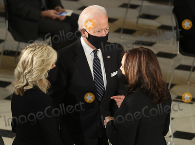 Photo - Democratic Presidential Candidate Joe Biden talks with Democratic Vice Presidential candidate Sen Kamala Harris (D-CA)  and his wife Dr Jill Biden (L) during a ceremony where US Supreme Court Associate Justice Ruth Bader Ginsburgs flag-draped casket will lie in state at the US Capitol on September 25 2020 in Washington DC Ginsburg who was appointed by former US President Bill Clinton served on the high court from 1993 until her death on September 18 2020 She is the first woman to lie in state at the Capitol (Photo by Chip SomodevillaGetty Images)Credit Chip Somodevilla  Pool via CNPAdMedia