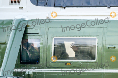Photos From U.S. President Joe Biden and first lady Jill Biden wave from Marine One in Washington