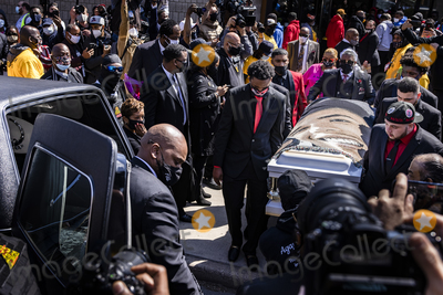 Ministry Photo - Brothers and friends of Daunte Wright carry his casket draped with a blanket bearing his face to a hearse at Shiloh Temple International Ministries following his funeral in Minneapolis Minn US on Thursday April 22 2021 Wright was shot by police officer Kimberly Ann Potter who claims she thought she was deploying a taser when Wright attempted to flee as police attempted to place him under arrest for an outstanding warrant during a traffic stopCredit Samuel Corum  CNPAdMedia