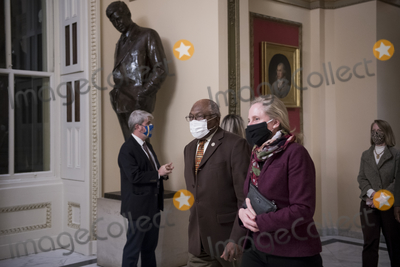 Photos From United States Representative Abigail Spanberger (Democrat of Virginia) and United States House Assistant Democratic Leader James Clyburn (Democrat of South Carolina) walk to the House chamber at the US Capitol during a vote.