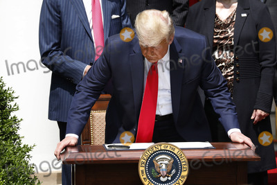 Photos From Donald Trump signs PPP Flexibility Act