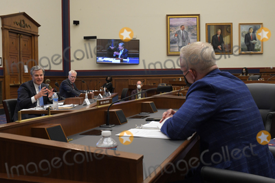 Photo - Christopher Wray Director Federal Bureau of Investigation (FBI) testifies before the US House Committee on Homeland Security in Washington DC  on September 17 2020  Acting Secretary of HHS Chad Wolfs empty chair indicates he is a no show at the hearingCredit John McDonnell   Pool via CNPAdMedia