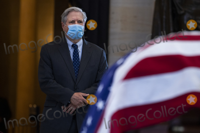 Photo - UNITED STATES - APRIL 13 United States Senator John Hoeven (Republican of North Dakota) pays respects to US Capitol Officer William Billy Evans as his remains lie in honor in the Capitol Rotunda in Washington DC on Tuesday April 13 2021 Evans was killed when a driver rammed the north barricade of the Capitol on April 2 2021Credit Tom Williams  Pool via CNPAdMedia
