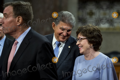 Photo - United States Senator Joe Manchin III (Democrat of West Virginia) center chats with United States Senator Susan Collins (Republican of Maine) right while United States Senator Mark Warner (Democrat of Virginia) left makes remarks after the vote on the motion to invoke cloture to proceed to the consideration of HR 3684 the INVEST in America Act on Capitol Hill in Washington DC on Wednesday July 28 2021 The vote to begin discussion of the bipartisan infrastructure bill agreed to by the White House was 67 to 32 If passed the bill would invest close to 1 trillion in roads bridges ports and other infrastructure without a major tax increaseCredit Rod Lamkey  CNPAdMedia