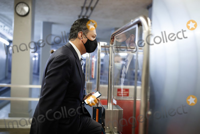 Alex Padilla Photo - Senator Alex Padilla a Democrat from California wears a protective mask while boarding the Senate Subway at the US Capitol in Washington DC US on Thursday Feb 11 2021 House prosecutors used the second day of Donald Trumps impeachment trial to detail a months-long campaign by the former president to stoke hatred and encourage violence over the election results that they said culminated in the mob attack on the US Capitol that he then did little to stop Credit Ting Shen - Pool via CNPAdMedia