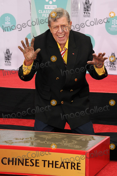 Jerry Lewis Photos - 20 August 2017 - Jerry Lewis the brash slapstick comic who became a pop culture sensation in his partnership with Dean Martin and then transformed himself into an auteur filmmaker of such comedic classics as The Nutty Professor and The Bellboy has died in Las Vegas at the age of 91 For most of his career Lewis was a complicated and sometimes polarizing figure An undeniable comedic genius he pursued a singular vision and commanded a rare amount of creative control over his work with Paramount Pictures and other studios He legacy also includes more than 25 billion raised for the Muscular Dystrophy Association through the annual Labor Day telethon that he made an end-of-summer ritual for decades until he was relieved of the hosting job in 2011 In addition to his most famous films Lewis also appeared in a number of notable works such as Martin Scorseses The King of Comedy but was largely offscreen from the late 60s on and was more active with his telethon and philanthropic efforts As late as 2016 Lewis continued to perform in Las Vegas where he first debuted his comedy routine back in 1949 File Photo 12 April 2014 - Hollywood California - Jerry Lewis 2014 TCM Classic Film Festival - Jerry Lewis Hand  Footprint Ceremony held at the TCL Chinese Theatre Photo Credit Byron PurvisAdMedia