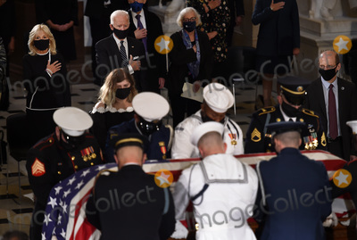 Photo - Former vice president and Democratic presidential nominee Joe Biden (2-L) and his wife Jill Biden (L) pay their respects to the late Associate Justice Ruth Bader Ginsburg as her casket lies in state during a memorial service in her honor in the Statuary Hall of the US Capitol September 25 2020 in Washington DCCredit Olivier Douliery  Pool via CNPAdMedia