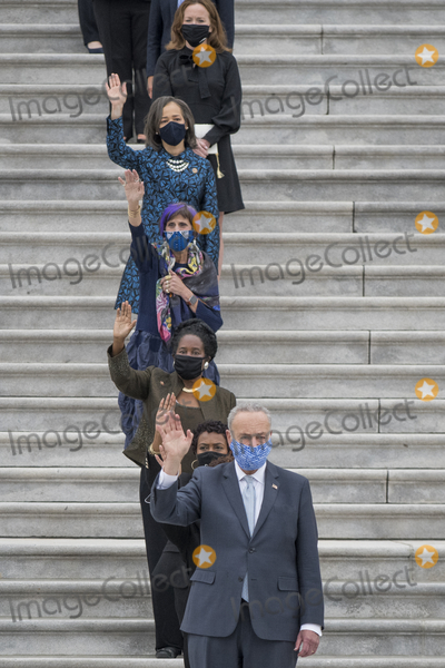 Photo - United States Senate Minority Leader Chuck Schumer (Democrat of New York) center joins other members of Congress as they wave good bye while the casket carrying Supreme Court Justice Ruth Bader Ginsburg departs the US Capitol in Washington DC Friday September 25 2020 after lying in state in Statuary Hall Justice Ginsburg died from her battle with pancreatic cancer and is the first woman to lie in state at the US Capitol Credit Rod Lamkey  CNPAdMedia