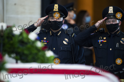 Photo - UNITED STATES - APRIL 13 US Capitol Police Officers pay respects to Officer William Billy Evans as his remains lie in honor in the Capitol Rotunda in Washington DC on Tuesday April 13 2021 Evans was killed when a driver rammed the north barricade of the Capitol on April 2 2021Credit Tom Williams  Pool via CNPAdMedia